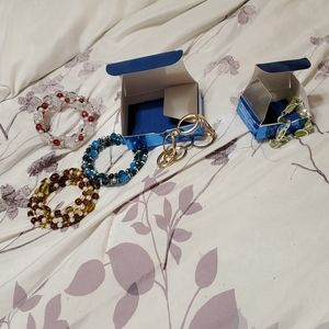 5 bracelets, 1 goldtone, green, brown, blue, red